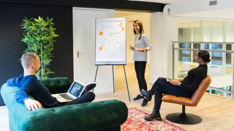 woman making a presentation to two colleagues